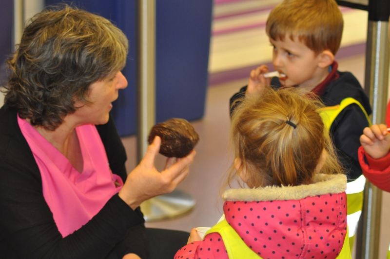 Practitioner showing the children the cocoa bean