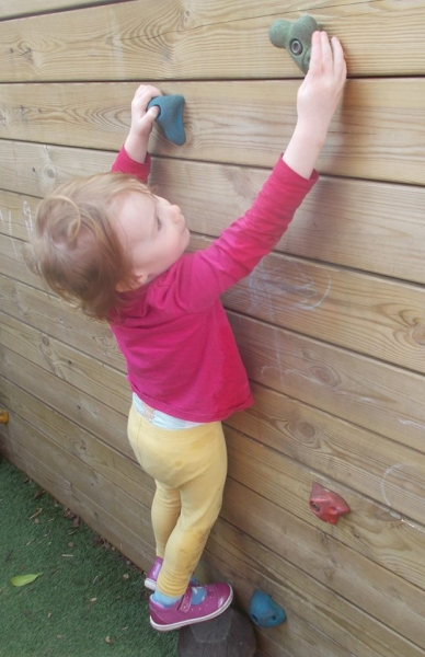Climbing Up The Outdoor Climbing Wall
