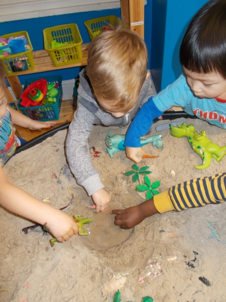 Playing together with the dinosaurs