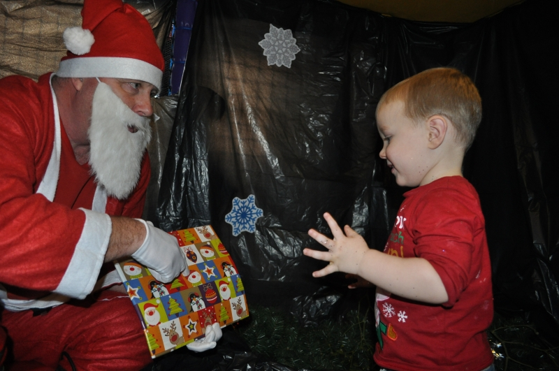 Receiving present from Father Christmas