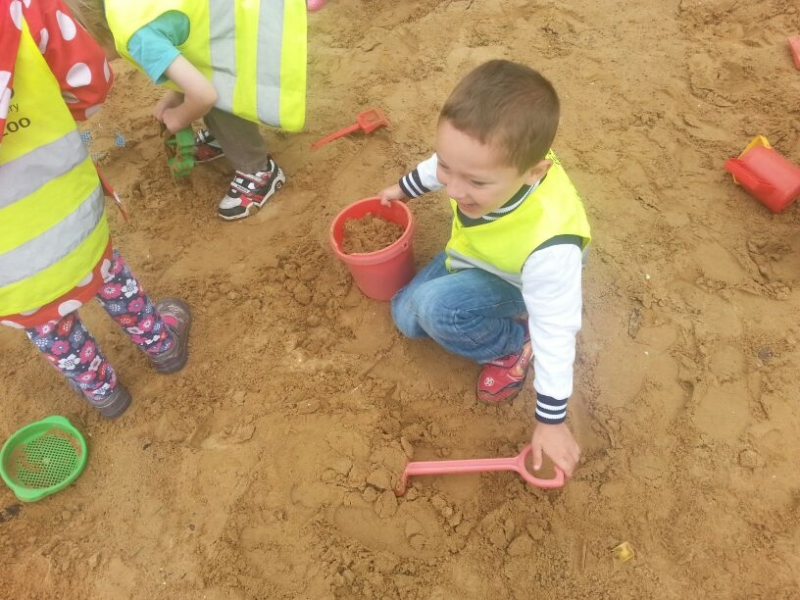 Digging in the sand pit.