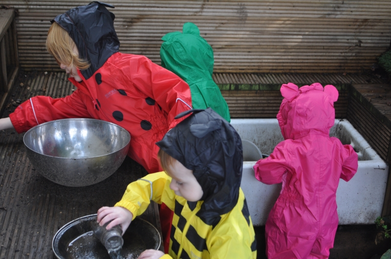 Making mud pies in the mud kitchen