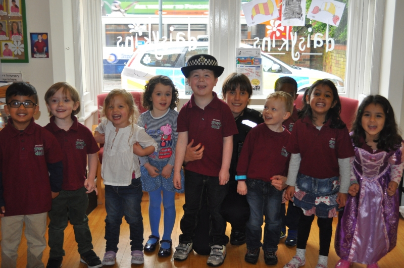 A group photo of the children and police lady