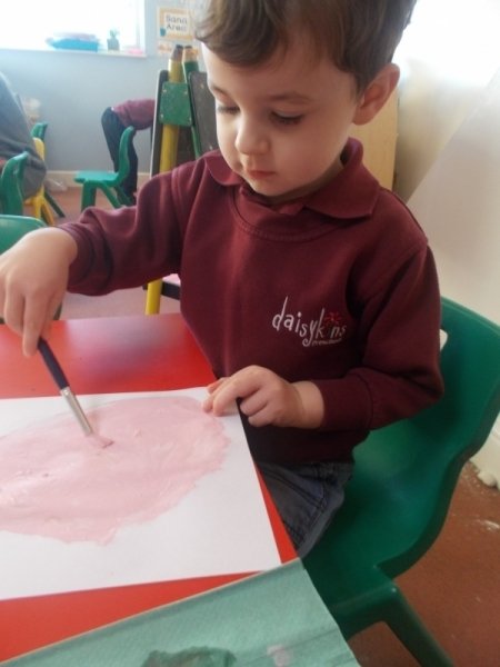 Using a paintbrush to paint