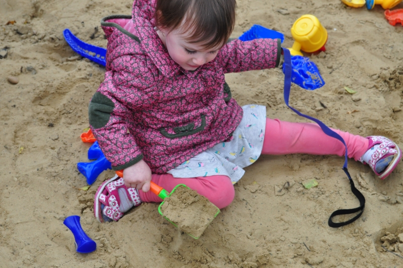 Playing in the large sand area