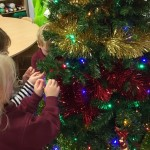 Children at new Rugby Nursery decorate Christmas tree