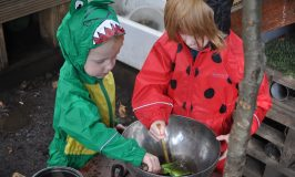 Getting muddy in our mud kitchen area